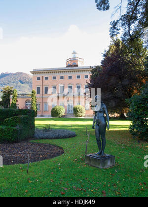 Lugano, Switzerland - Oktober 16, 2015: Villa Ciani and statue in the forecourt - Stock Photo