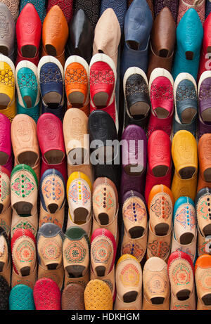 Babouches, coloured traditional Moroccan slippers. Fez, Morocco. - Stock Photo