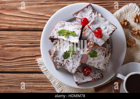 chocolate cake brownie with walnuts and coffee. horizontal view from above - Stock Photo