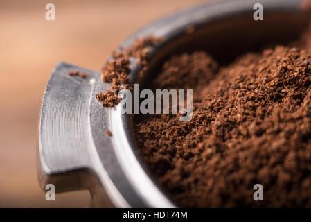 Ground coffee in porta filter holder - Stock Photo