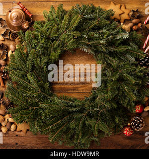 Christmas pine wreath with spices and candy cones - Stock Photo