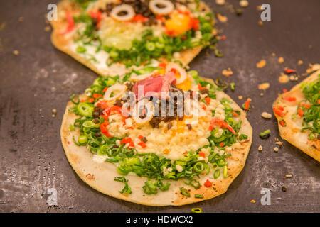 Japanese traditional food, okonomiyaki or Japanese pizza - Stock Photo