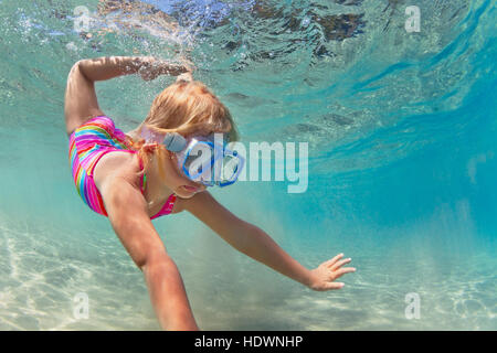 Happy baby girl in snorkeling mask swim and dive underwater with fun in sea pool Healthy lifestyle, people water - Stock Photo