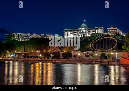 Georgia, Tbilisi night . View from the right bank of the Kura River in the complex of the Presidential Palace and - Stock Photo