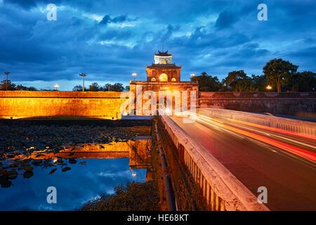 Moat and wall of The Citadel (Imperial City) illuminated at dusk. Hue, Vietnam. - Stock Photo