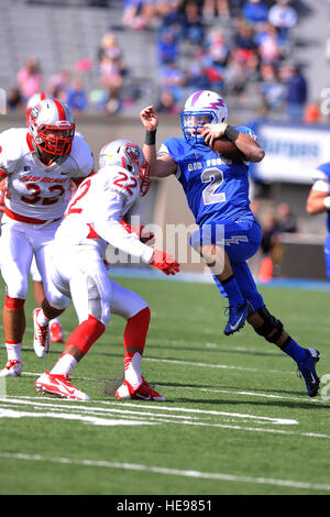 Kale Pearson, No. 2, a quarterback with the U.S. Air Force Academy Falcons, tries to avoid Markel Byrd, No. 22, - Stock Photo