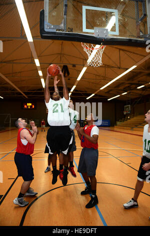 SPANGDAHLEM AIR BASE, Germany – Aramis Williams, 52nd Civil Engineer Squadron, rebounds the ball during a basketball - Stock Photo