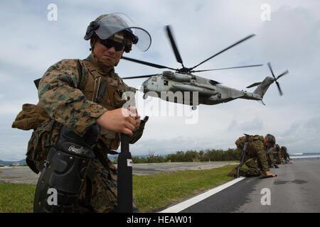 Cpl. Jordan Canchola, an artillery gunner with Golf Battery, Battalion Landing Team 1st Battalion, 5th Marines, - Stock Photo
