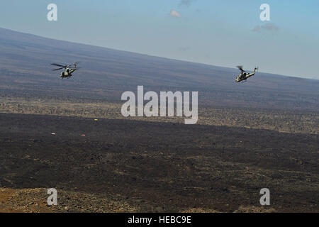 A U.S. Marine Corps UH-1Y Venom and a AH-1W Super Cobra from Marine Light Attack Helicopter Squadron 169 (HMLA-169) - Stock Photo