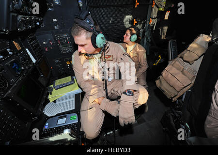 U.S. Air Force Capt. Jeff Mitchell, navigator, (left) and Airman 1st Class Jamie Dalton, airborne mission systems - Stock Photo