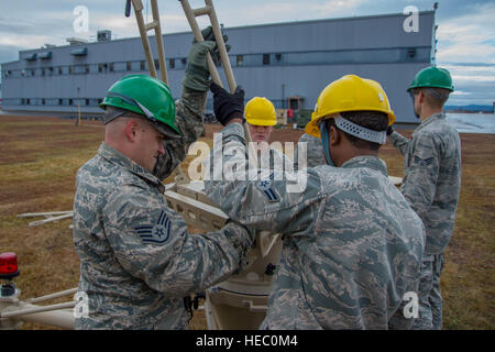U.S. Airmen with the 52nd Combat Communications Squadron build a ground multiband terminal during Vigilant Shield - Stock Photo