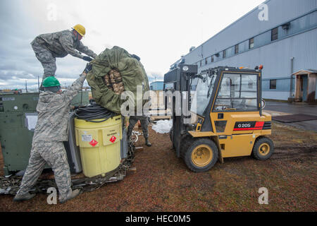 U.S. Airmen with the 52nd Combat Communications Squadron load a tent onto a forklift during Vigilant Shield 15 at - Stock Photo