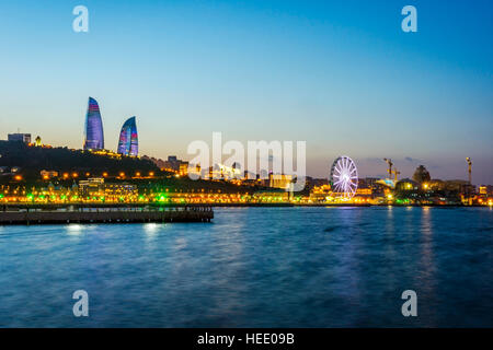View over Baku skyline with Flame towers at night, Azerbaijan - Stock Photo