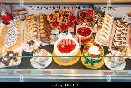 Window display of cakes at Café Patisserie Valerie in Middlesbrough - Stock Photo