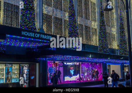 The entrance to  The House Of Fraser on London's Oxford St at Christmas time , The shop all decked out in Christmas - Stock Photo