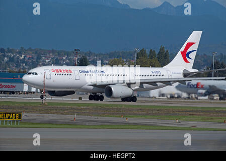 A China A330-243 Wide Bodied Eastern Airliner departs from South Vancouver airport, BC Canada.  SCO 11,288. - Stock Photo