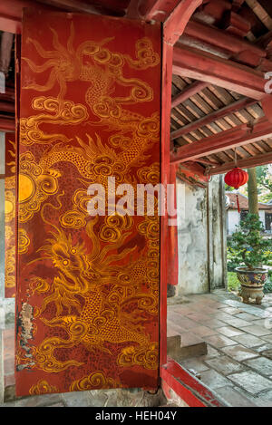 Red doors with golden dragons at the ancient Confucian Temple of Literature (Van Mieu-Quoc Tu Giam) in Hanoi, Vietnam - Stock Photo