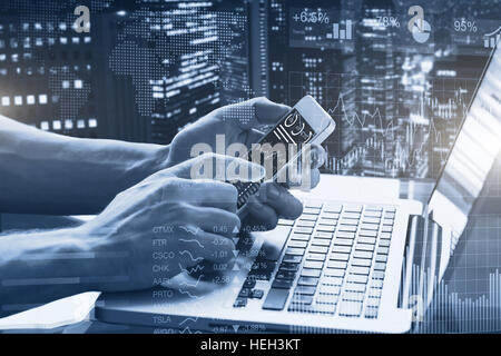 Double exposure of abstract financial graphs, business person in office using smartphone and laptop computer with - Stock Photo