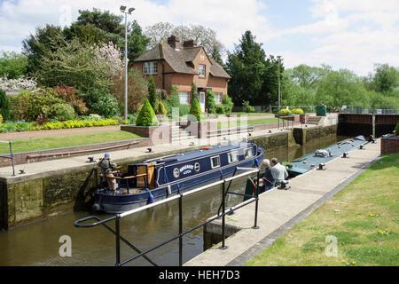 A narrow boat passing through Hambleden lock on the river Thames, Berkshire, England - Stock Photo