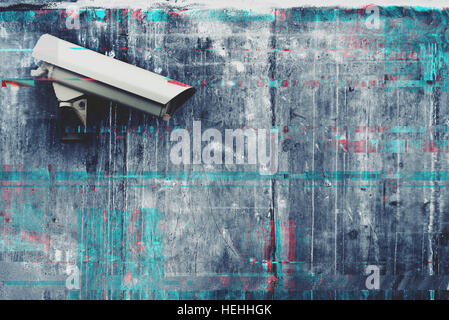 CCTV security and surveillance camera with digital glitch effect - Stock Photo