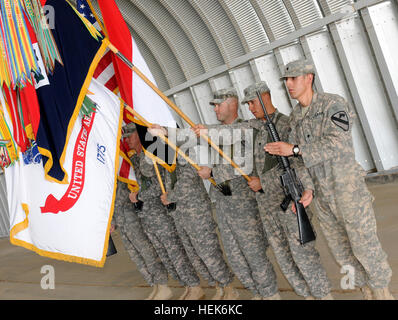 Soldiers present and post the colors of the 4th Infantry Division during the division's color casing ceremony at - Stock Photo