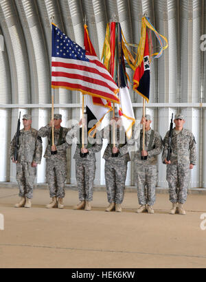 Soldiers present and post the colors of the 4th Infantry Division during the division's color casing ceremony in - Stock Photo