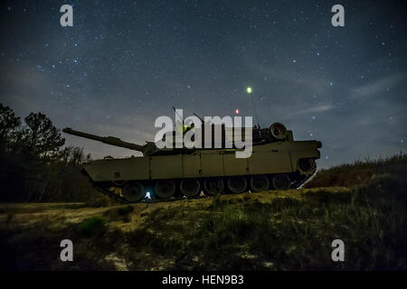 """FORT STEWART, Ga. -- An M1A2SEP Abrams tank from Company D, 1st Battalion, 64th Armor Regiment """"Desert Rogues"""", - Stock Photo"""