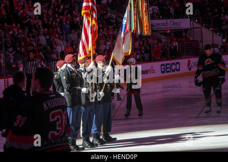 Paratroopers of the 1st Squadron, 73rd Cavalry Regiment color guard present the national and Army flags during the - Stock Photo