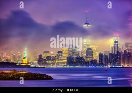 New York City skyline on a foggy night. - Stock Photo