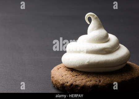 Hot chocolate cookies with marshmallow meringue on blackboard  background - Stock Photo