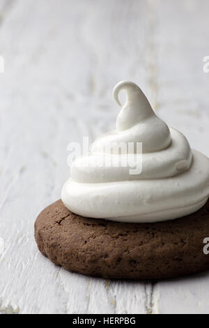 Hot chocolate cookies with marshmallow meringue on white rustic background - Stock Photo