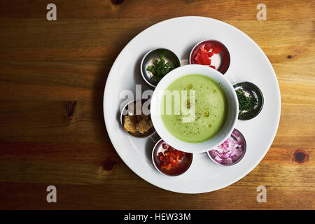 Overhead view of bowl with dipping sauce and chopped vegetables,  Antigua, Guatemala - Stock Photo