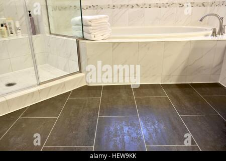 A luxury white marble bathroom in a modern home - Stock Photo