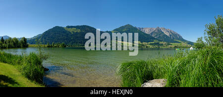 Austria, Tyrol, Walchsee with Zahmer Kaiser - Stock Photo