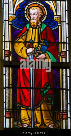 Stained Glass window depicting Saint Paul in the Cathedral of Ghent, Flanders, Belgium. - Stock Photo