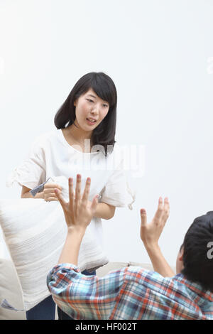 Young Japanese couple fighting - Stock Photo