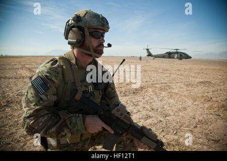 A coalition force member maintains security during a medical evacuation in Farah province, Afghanistan, Nov. 24, - Stock Photo