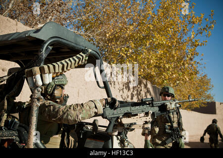 A coalition force member maintains security during a presence patrol in Farah province, Afghanistan, Dec. 9, 2012. - Stock Photo