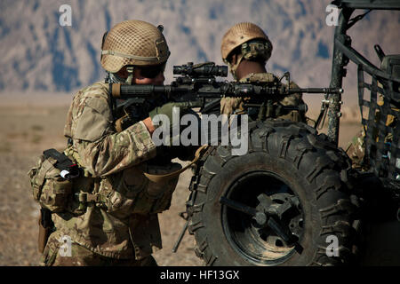 A coalition force member maintains security during a presence patrol in Farah province, Afghanistan, Dec. 13, 2012. - Stock Photo