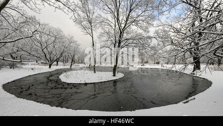 The view within a city park near Old Town in Warsaw, Poland after heavy snowfall during the previous night. - Stock Photo