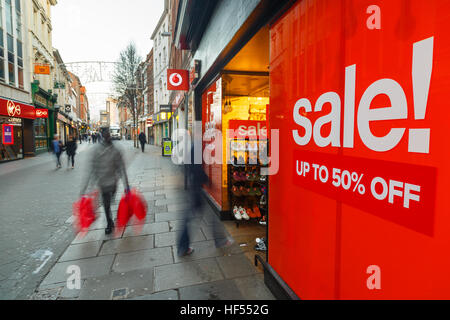 Boxing Day sales poster and sales shoppers on Clumber Street in Nottingham, Britain. In Nottingham, England. On - Stock Photo