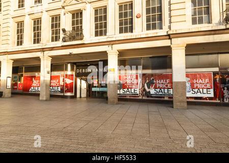 Half price sale posters in windows at Debenhams. In Nottingham, England. On 26th December 2016. - Stock Photo