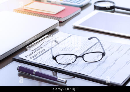 Businessman or job seeker fill in Employment Application form with pen. job vacancy concept. - Stock Photo