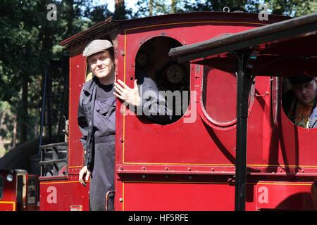 Rural Life Centre Tilford Surrey train driver mate summer steam - Stock Photo