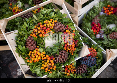 Denmark, Copenhagen, traditional Christmas wreath, made from berries, pine cones and green foliage - Stock Photo