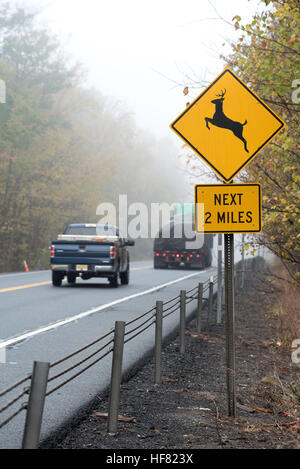 Deer crossing highway sign on Highway 4 in Washington County, New York. - Stock Photo