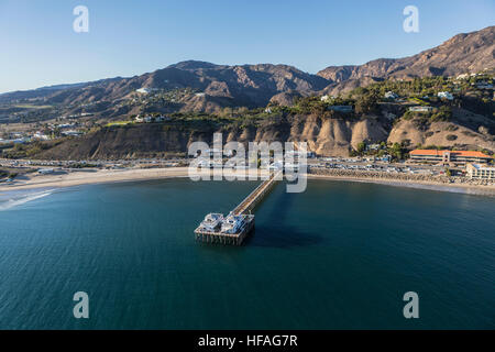 Aerial of the historic Malibu Pier, beaches and the Santa Monica Mountains on the Southern California Pacific Coast. - Stock Photo