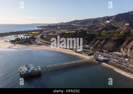 Aerial of historic Malibu Pier, Pacific ocean beaches and the Santa Monica Mountains in Southern California. - Stock Photo