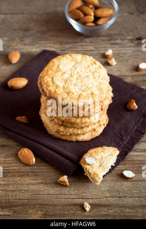 Homemade almond cookies on wooden table with copy space - healthy homemade vegan vegetarian pastry with almonds - Stock Photo