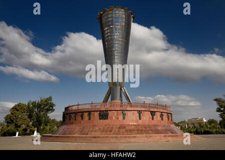 Full view of Altyn Shanyrak monument with large gates to Independence Park in Shymkent Kazakhstan - Stock Photo